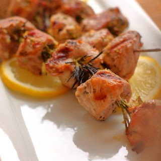 Tender pork is skewered on fragrant rosemary sprigs and marinated in garlic and lemon for a delicious and different kabob.