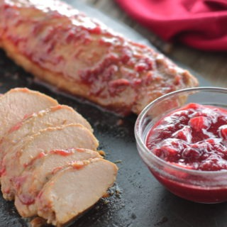 Seasonal cranberries and apple make a flavorful glaze and sauce for pork tenderloin.
