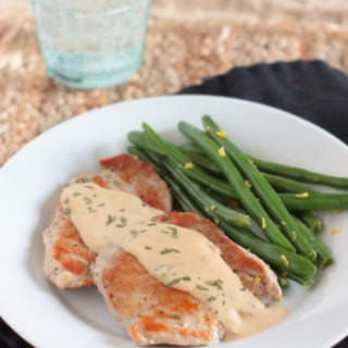 Pork Rosemary Creamy Dijon - Tender boneless pork chops with a rich herbed cream sauce come together in only fifteen minutes; perfect for a weeknight.