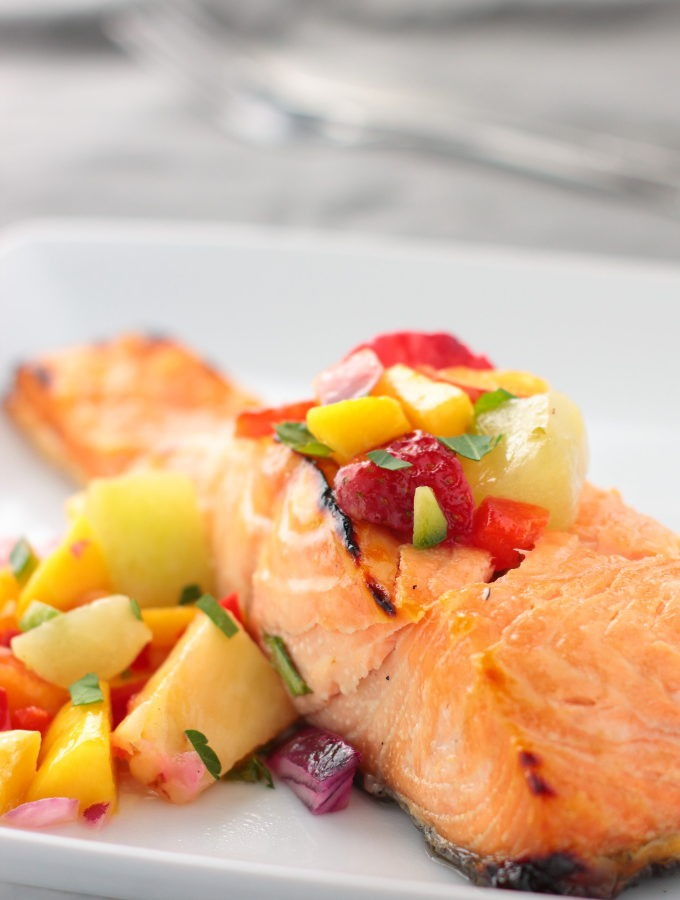 Simple grilled salmon with a fresh salsa made from ripe summer fruit is a quick and delish weeknight dinner.